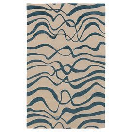 """Anchor your living room or define a space in your master suite with this hand-tufted rug, showcasing an abstract geometric motif in blue.  Product: RugConstruction Material: 100% New Zealand woolColor: Blue and ivoryFeatures:  Hand-tuftedPlush pileArt silk accents Made in India    0.63"""" Pile height  Note: Please be aware that actual colors may vary from those shown on your screen. Accent rugs may also not show the entire pattern that the corresponding area rugs have.Cleaning and Care: ..."""