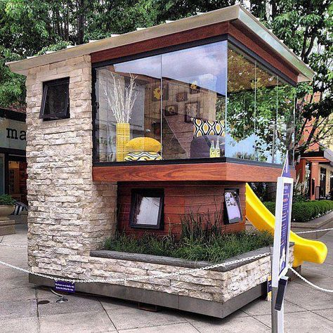This modern playhouse is too cool. Glass windows, multiple levels, and a slide make this space the ultimate luxury hideout.   Source: Instagram user chefomeo #kidsplayhouse