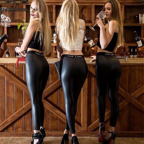 Three women in leggings at the bar.