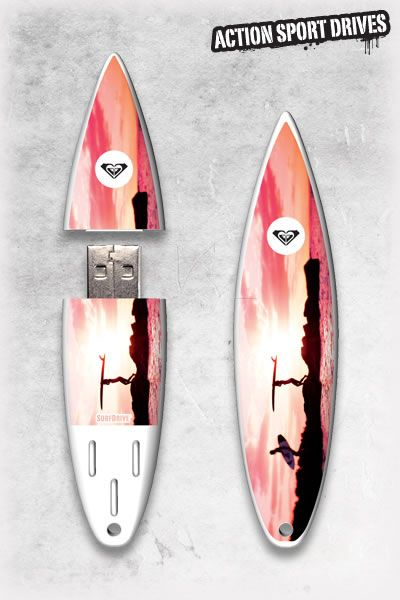 Roxy SurfDrive : Pink Sunset USB Flash Drive // Action Sport Drives have teamed up with the best surfboard companies in the industry to create the original USB Flash Drive short surfboard. We've combined this innovative design with Roxy graphics like their Pink Sunset Model.    Now you can get your favorite surfboard graphics, and transfer files in style.