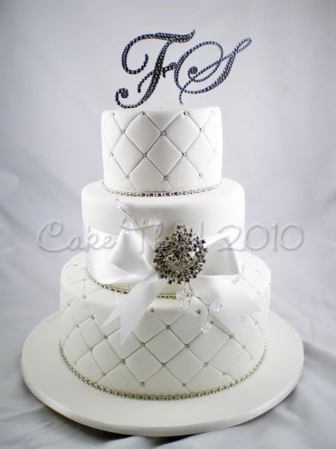 """A three tier White cake- with Strung diamantes- Silver cachous- A crystal Brooch- and all topped off with a """"full Bling"""" set of Crystal Couture cake toppers. - http://cakethat.blogspot.co.uk/2010/10/hello-october.html#"""