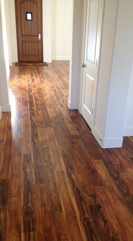 love the look of this laminate flooring! can't wait to get our house done  soon!---Me too-great look for new wood floors