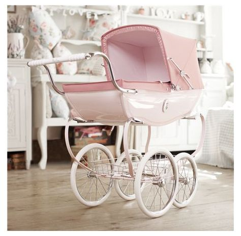 Vintage babycarriage, pink, of course - and even if it's a boy!
