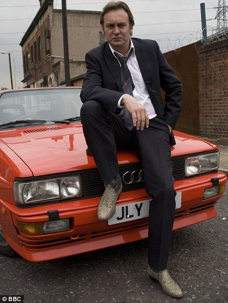 """Gene Hunt (Philip Glenister) of """"Life on Mars"""" and """"Ashes to Ashes"""".  Fire up the Quattro."""