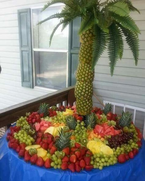 Pineapple palm tree fruit display... I absolutely adore this! Too lavish for his birthday, but it's awesome!