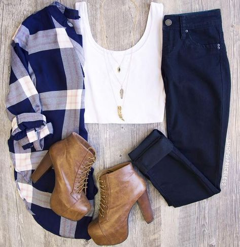 With different shoes I really love this outfit. A slightly oversized plaid tunic over skinny jeans with brown booties = love