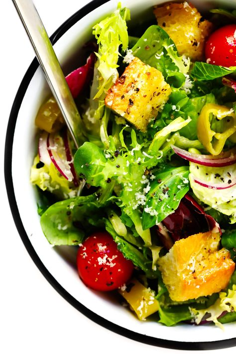 LOVE this easy Italian salad recipe! It's inspired by the Olive Garden, and made with fresh greens, croutons, pepperoncini, red onions, Parmesan, and a zesty (super simple!) Italian vinaigrette. Serve it as a side salad or as an entree!   gimmesomeoven.com #italian #salad #healthy #side #vegetarian #dinner #recipe