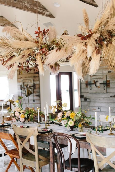 Well, the verdict is in! This vintage bohemian dinner party takes the cake for cutest of all time. With an upscale Southern feast, a wheat and burgundy floral chandelier and the most darling collection of mismatched chairs, you will not want to miss the b