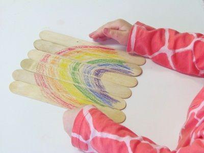Craft stick rainbow puzzles in preschool