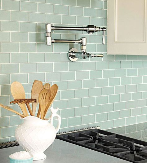 Tranquil Scene Blue-green glass subway tiles give off a tranquil air in this kitchen. The subtle white grout lines give the tiles additio...
