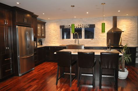 Dark Kitchen Cabinets, White Granite With Tigerwood Flooring. Backsplash Of  Natural White Quartz Adds Extra Sparkle With Pot Lights. Green Accentu2026