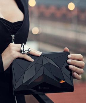 Love this unique and geometric clutch!