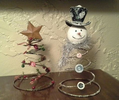 Upcycle bed springs into snowman and Christmas tree, thanks to the great ideas on Pinterest!