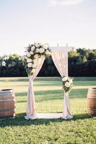 Rustic Wedding Decor White Wooden Arch Decorated With White Cloth