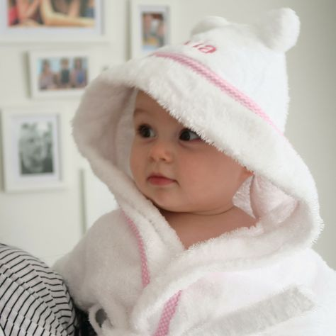 This beautiful towelling robe is available in white with a gorgeous pink gingham edging. The hood is embroidered with your baby's name, or you could choose a date, or any word you choose. The perfect gift for Christmas or Christenings, baby showers or birthdays, we love how practical and adorable this is! And we love how cute Olivia looks in hers! In thick 100% ring spun cotton and washable at 60 degrees this is practical as well as beautiful. It makes a perfect and timeless gift and will be che