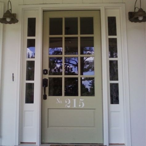 A front door in a classic neutral color goes well with all white trim and white siding