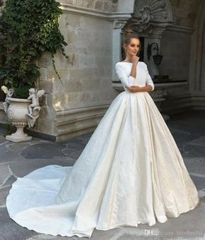 2018 New Simple Satin Ball Gown Wedding Dresses 34 Long Sleeves Backless Ball Gown Co With Images Celebrity Wedding Dresses Wedding Dresses Romantic Modest Wedding Dresses