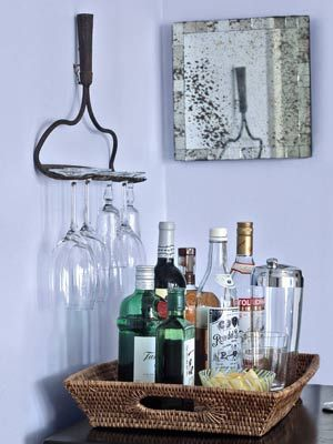 """Rake stemware holder: Remove handle. Carefully cut it off, sand cut end. Use 3/16"""" metal drill bit to drill 2 holes per rake head directly into center of handle's back side, 1"""" apart. Screw rake heads into wall with 3"""" toggle bolt or 3"""" anchor screws."""