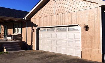 Garage Door Spring Repair Ny In 2020 Garage Door Spring Repair Garage Door Springs Garage Door Installation