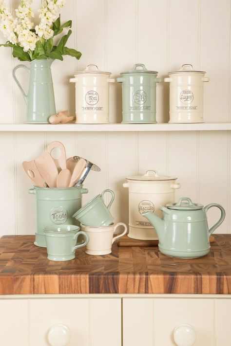 Vintage kitchen storage in rustic cream and rustic green | Image via beautifulkitchensblog.co.uk