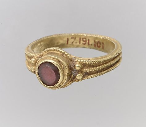 Finger Ring Date: 4th-7th century Culture: Langobardic ~ The symbol of all ring is infinity, never ending in their shape as a circle. The round setting may be the sun; with the garnet representing protection. The garnet gets its name from the Latin word for pomegranate, I believe, which also could give the stone the ancient attributes of the pomegranate ---fruitfulness, learning and wisdom.