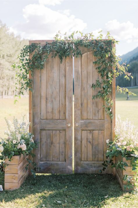 "From the editorial, ""A Breathtaking Pop Of Blue Wedding In Aspen"". The bride says, ""We loved the wood doors we had at the entrance of the meadow. Tyler and I picked those out at a warehouse sale and had them refurbished so they could stand alone in the meadow and create a special entrance with double doors as you might see in a beautiful church."" 