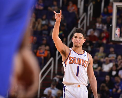 Devin Booker becomes youngest player in NBA history with back-to-back games