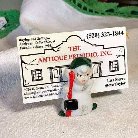 Where can you buy CHRISTMAS ELF PLACE CaRD HOLDeR? Here and it's porcelain and made by Commodore. #Christmas #ChristmasDecorations #HolidayDecor #ChristmasElf #PorcelainElf #Elf #PlaceCardHolder #ElfByCommodore #VintageElf #PlaceCardHolder #BusinessCardHolder #VintageChristmasElf #SmallElf