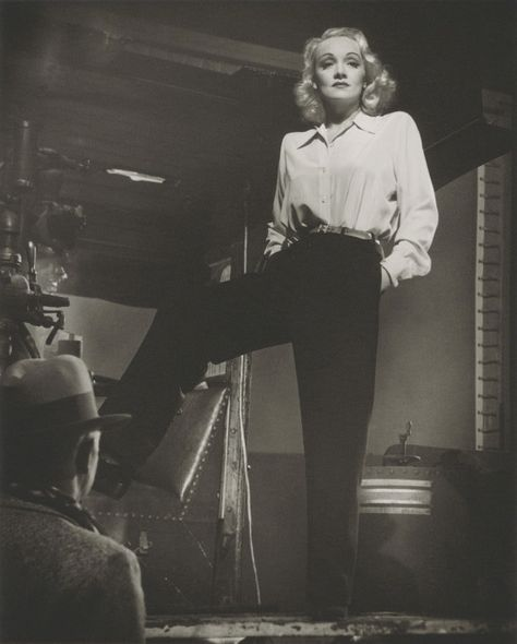 Marlene Dietrich, darling; White button up tucked into high-waisted somewhat tapered black pants with a belt