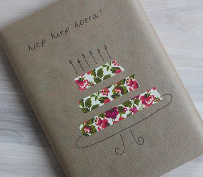 DIY wrapping paper art with brown paper bag, pen, & scrap pieces. Simple & you can add a personalized touch.