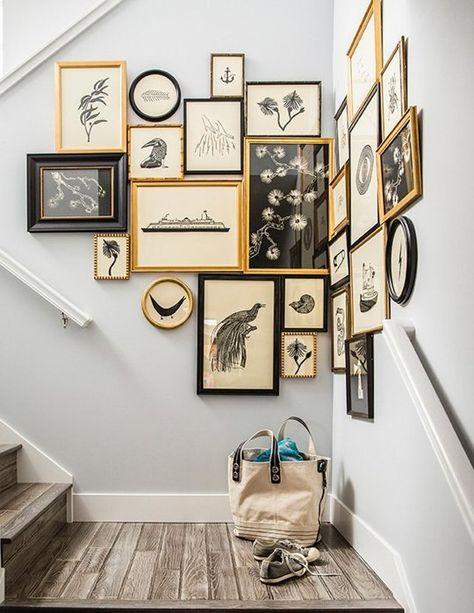 If you've been framed, you may as well make the most of it and create a feature corner wall! Cluster similar prints together in gold and black frames to add drama to a stairwell.