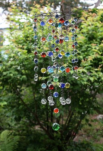 From Throw Away Marbles To Yard Mobile    i really like ths, might have to start one :)