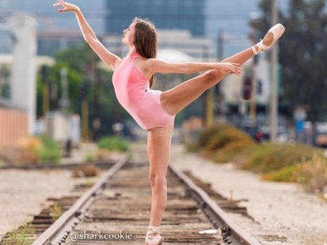 Dancing in the railroad tracks.