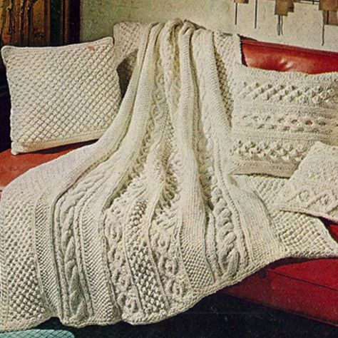 This delicious Aran Afghan knitting pattern has matching pillows. The design is vintage 1960s from American Thread.