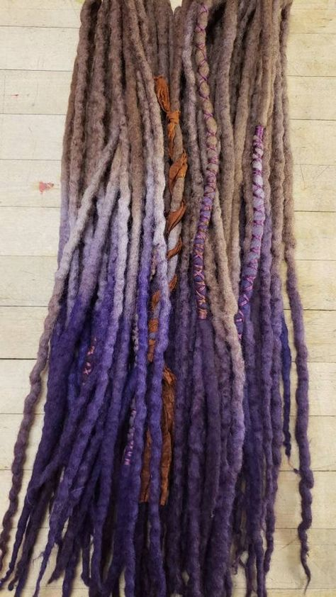 Check out this item in my Etsy shop https://www.etsy.com/listing/730277715/wool-dreadlocks-set-of-30-double-ended