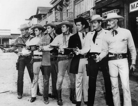 Stars from five different Warner westerns -- Maverick, Colt .45, Lawman, Sugarfoot & Bronco. Here we have (from left to right) Will Hutchins as Sugarfoot, Peter Brown as Johnny McKay, Jack Kelly as Bart Maverick, Ty Hardin as Bronco Lane, BRET MAVERICK, umm, I mean James Garner, Wayde Preston as Christopher Colt, and then...the LAWMAN! That's John Russell, who looks like Clark Gable when he smiles.