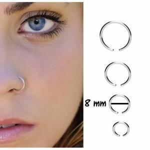 FAUX PIERCING Un piercing argenté nez sans perçage (faux piercin