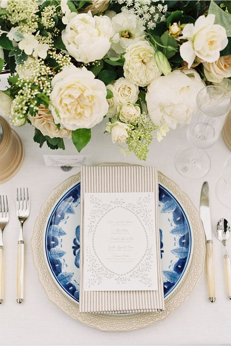 From the editorial A Classic Wedding in Neutral Pink Hues at The Admiral's House in Seattle. This reception had a timeless color palette with a subtle pop of blue and we swooning over the final look! More details on SMP!  Photography: @amandakphotoart  #weddingtable #weddingreceptiondecor #weddingtablesetting #classicweddinginspo