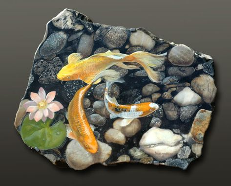 This wonderful river bottom granite from Brazil allows me to create a perspective looking down into the water with the plant, the Koi and then the bottom. Information at B R Gallery.