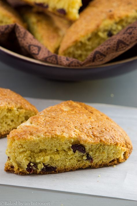 Tender and moist scones with orange flavors and dots of dried cranberries.