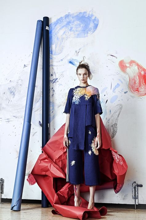 While working in the studio, paint is bound to drip, splatter, and brush up against an artist's clothes, transforming a studio uniform into a chaotic collection of attractive mishaps. Designer Olya Glagoleva in collaboration with Russian artist Lisa Smirnova (previously) captured this look with an e