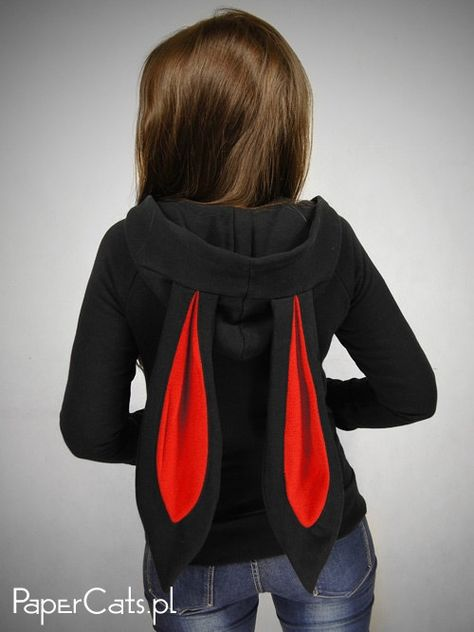 Sweatshirt made of black, stable cotton with polyester. The rabbit ears with red interior are sewn in hood. Strippers at the bottom and in the sleeves are black. Sweatshirt has a double, large hood. It fits with the indentation at the waist, suits perfectly to feminine figure.  Shipping time to: Europe to 10 days US and Canada 7- 30 days Australia and the rest of the world- 10-30 to days  Very rarely international shipping time may takes longer, so if you dont receive your order in 2 weeks pl...