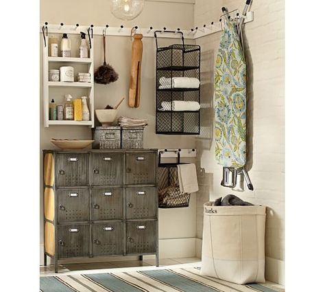 Laundry Room organization. I want the hanging baskets-love the pegs around the wall