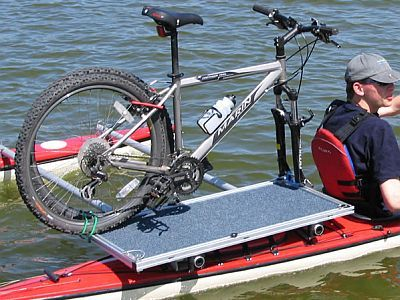 A Bike Being Carried On A Kayak With A Pontoon Attached Kayaking