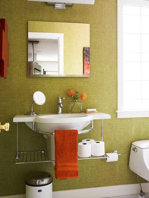 Green Bath with Deep Orange Accents -- love the wall covering.  this says it all for me.  Love the pedastal sink!