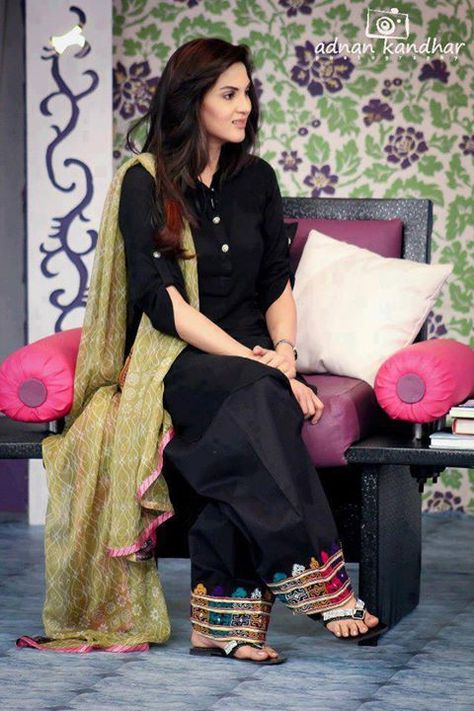 Black punjabi salwar suit, with multi-colored embroidery, and beige dupatta