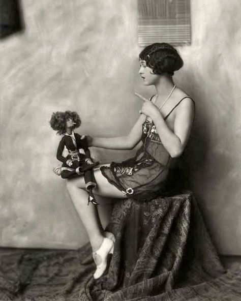 actress Lila Lee with a cigarette smoking doll, 1920s Photography Ziegfield Follies