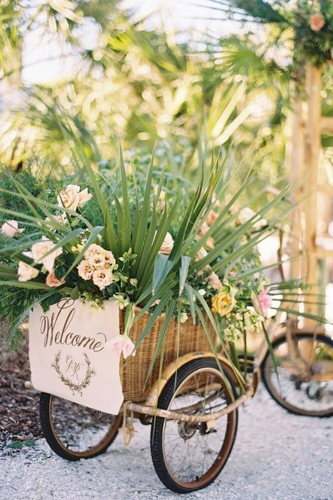 How much cuter can this welcome wagon get?! @maxowensdesign created the perfect arrangement of flowers and greenery to delight guests as they arrived at this rehearsal dinner. 😍 | Photography: @charlastorey #stylemepretty #weddingideas #welcomesign #weddinginspiration #weddingday