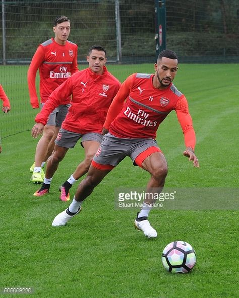 Alexis Sanchez and Theo Walcott of Arsenal during a training session at London Colney on September 16 2016 in St Albans England