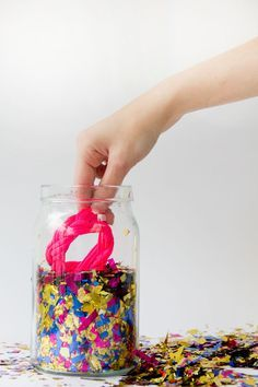 Hide a gift in a jar of confetti—a messy, but fun & unique way of giving a gift!